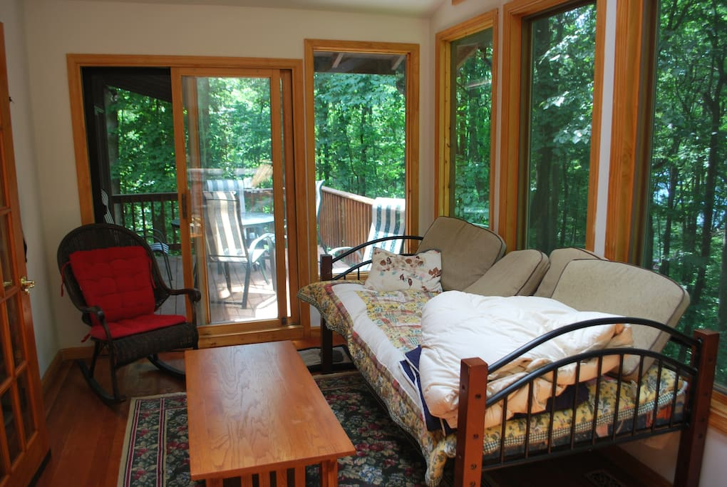 Sunroom off living room and dining area deck