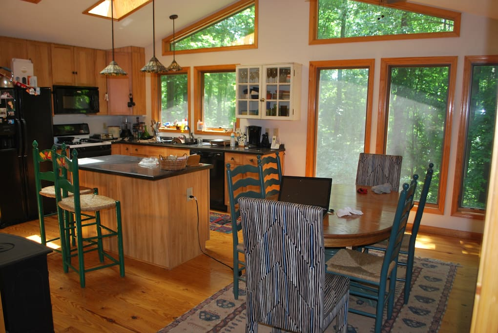 Dining area and kitchen with breakfast bar