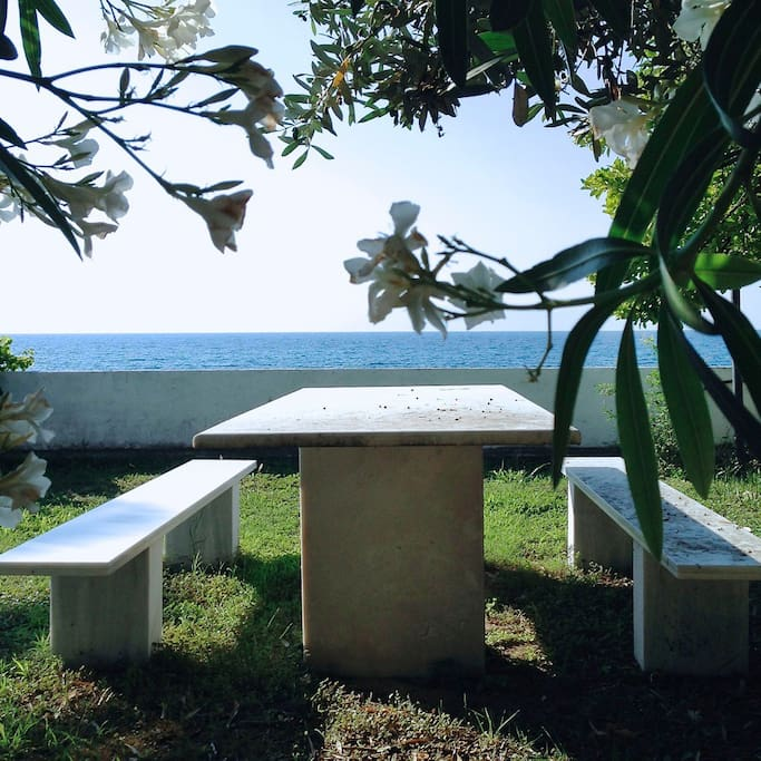 Marble dinning table in the garden in front of the sea