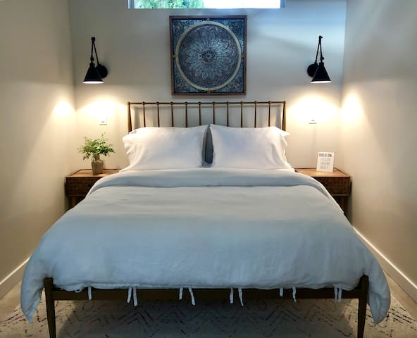Ground level Bedroom with queen size bed & organic linens