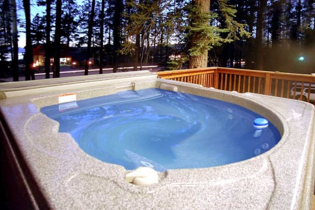 Hot tub on front deck with filtered lake views