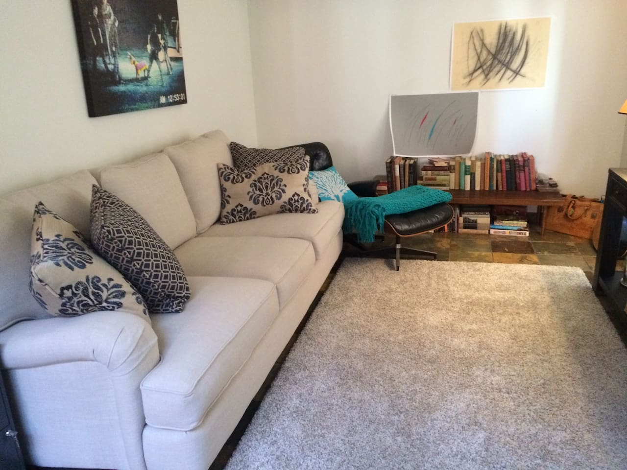 Living room offers cable tv and record player stocked with music.