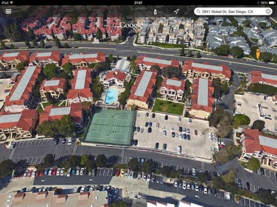 The condo is located to the right of the pool and the tennis court.