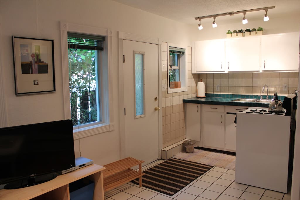 This photo shows the main entrance to the suite, and the kitchen.