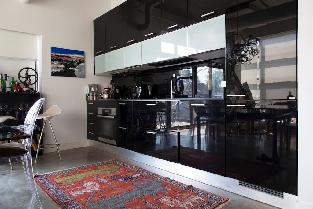 Ultra modern kitchen and antique rugs , a balanced interior to create a home like experience.