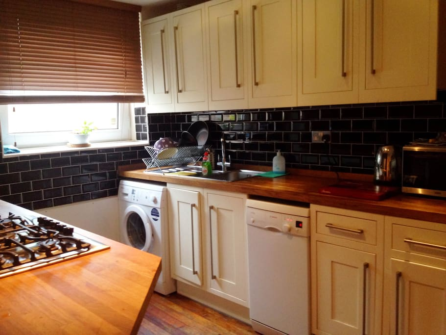 Modern kitchen fully-fitted with amenities.