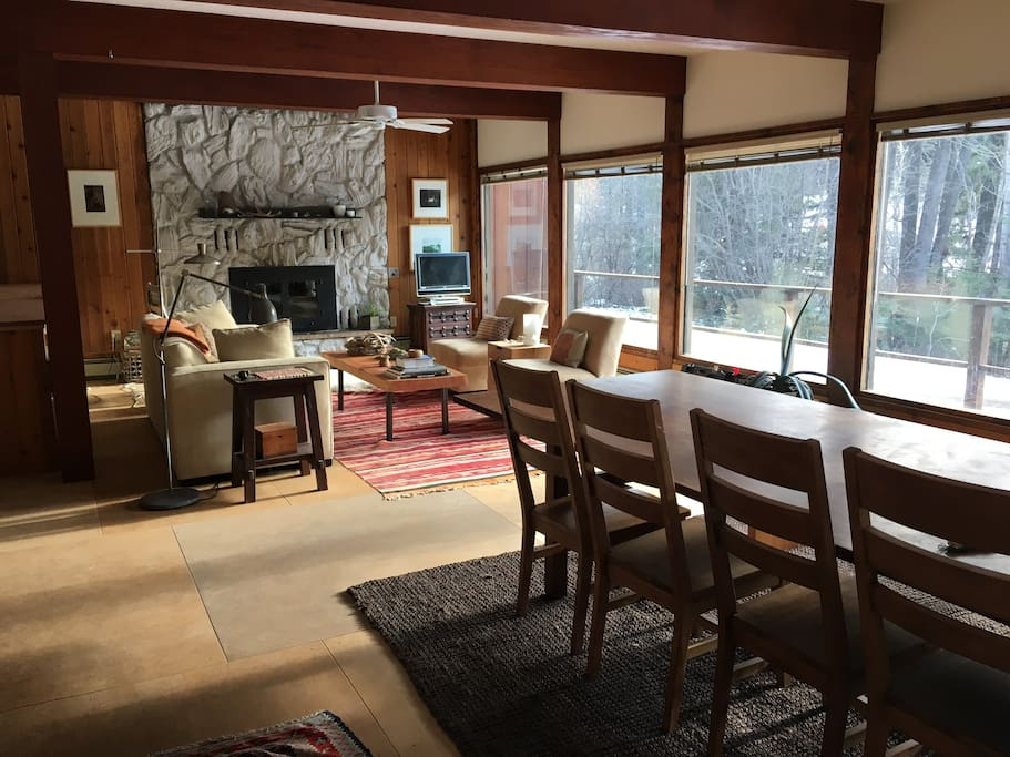 open dining, living and kitchen with views out