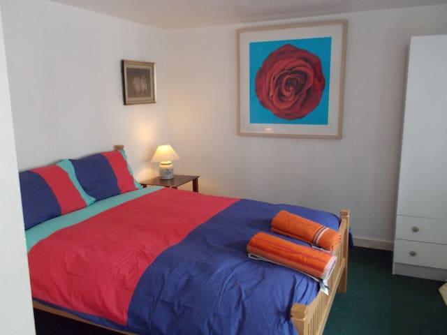 Bedroom is downstairs on RHS beside bathroom