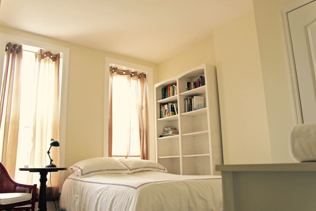 Private bedroom with double bed, dresser, closet, and extra shelving.