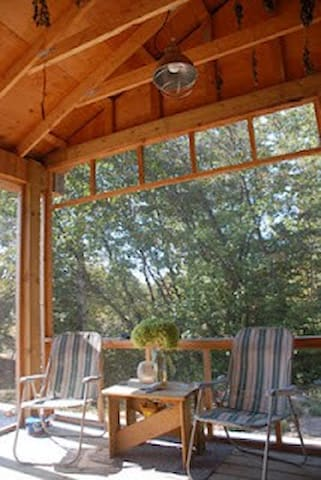 Screened-in portion of the deck.