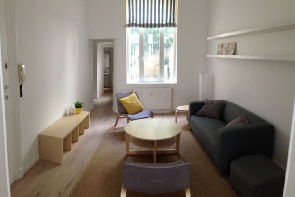 grande salle de séjour canapé comfort et chaises relax