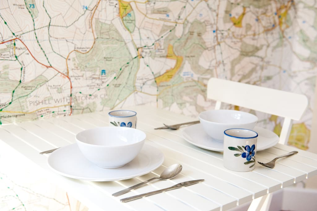Breakfast showing our lovely wall map of the area - great for planning walks