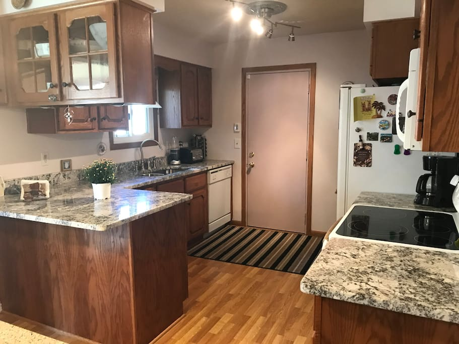 Kitchen with newer appliances and granite countertops