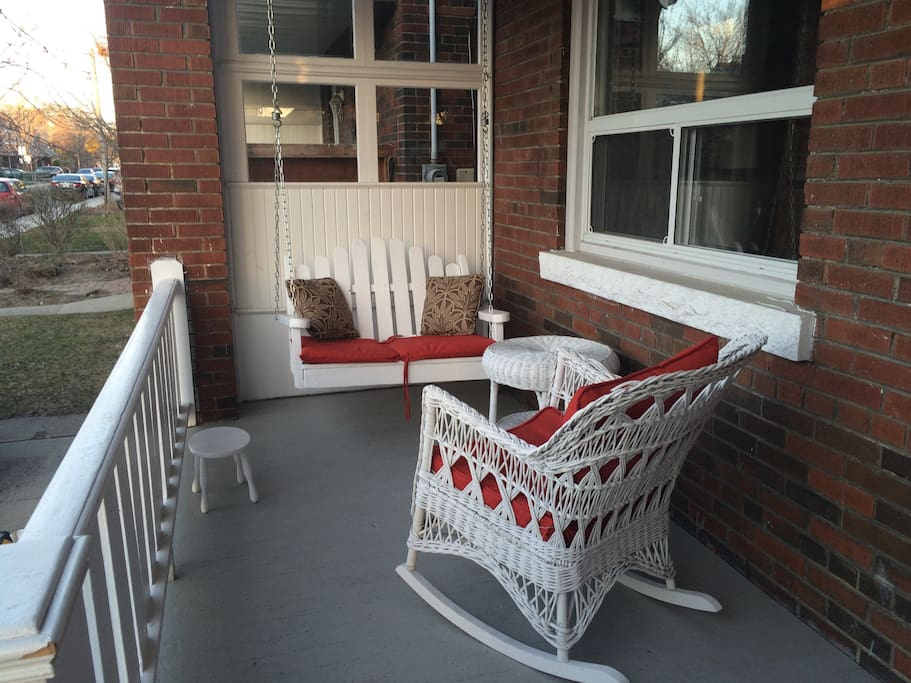 Shaded front porch, with an actual porch swing.