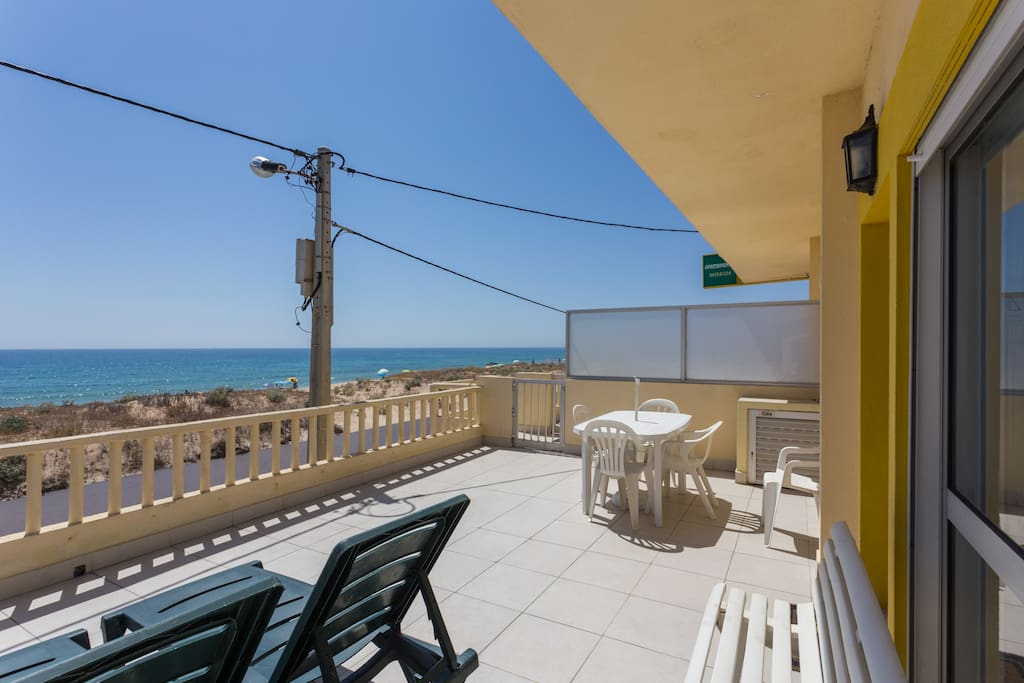 Private Terrace with chaise longues , table and chairs facing the sea with the best views!View of the terrace in front of the apartment. Amazing views from the apartment  to the coast line
