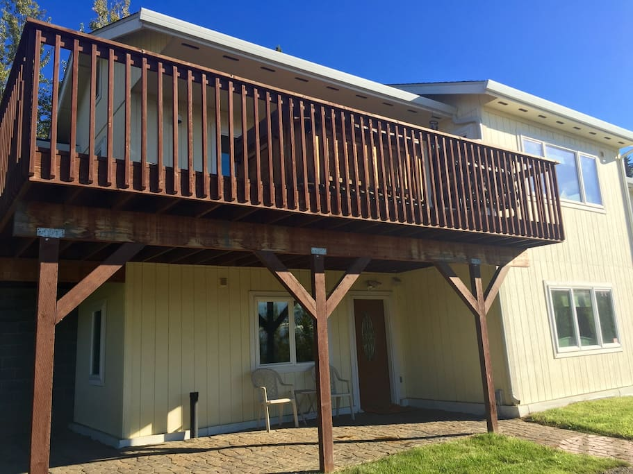 The downstairs apartment unit with wrap around covered porch.