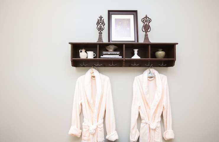 Cozy guest robes and NOLA novels.  Your room is also stocked with local magazines with restaurant and live music info.