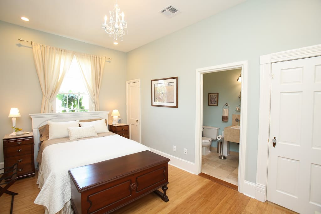 Your room features a clean and comfortable queen bed, 11-foot ceilings, antique furnishings, petite chandelier, bamboo flooring, and beautiful natural light.