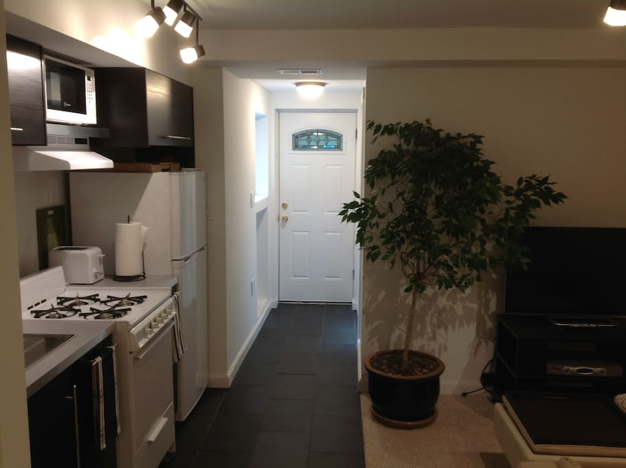 The unit has its own exterior private entrance and its own zoned AC and heating.
