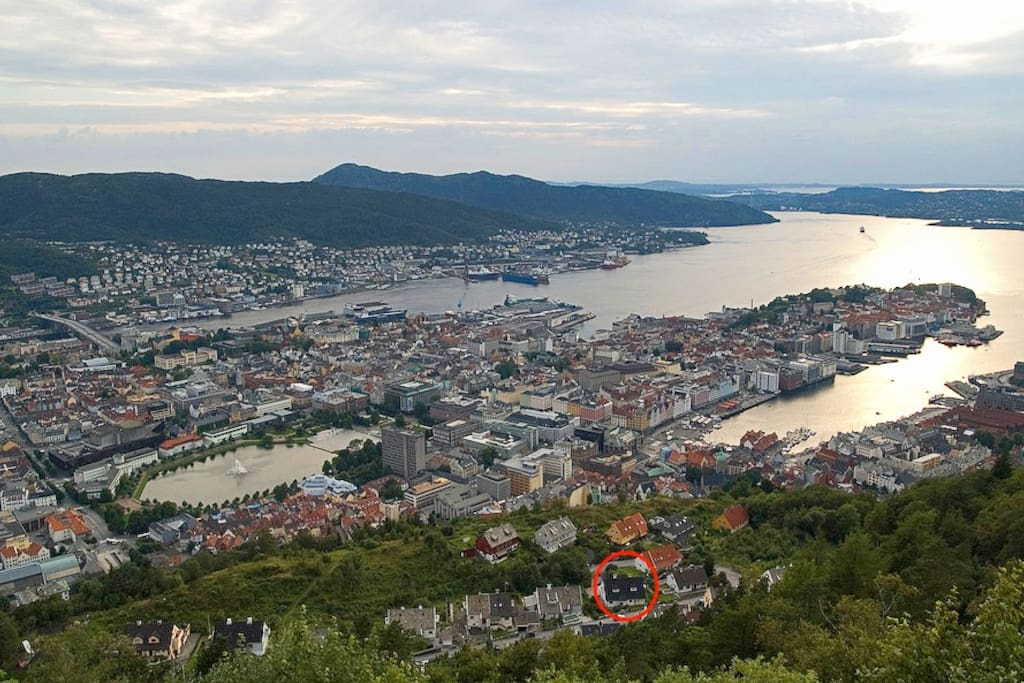 View from Mount Fløyen, the main tourist attraction in Bergen. Our house is located just below the top of mount Fløyen and is highlighted with the red circle on the lower part of the photo.