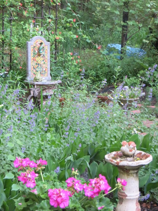 Mosaic Water fountain in Herb Garden. Spring/Summer view from English Garden bedroom