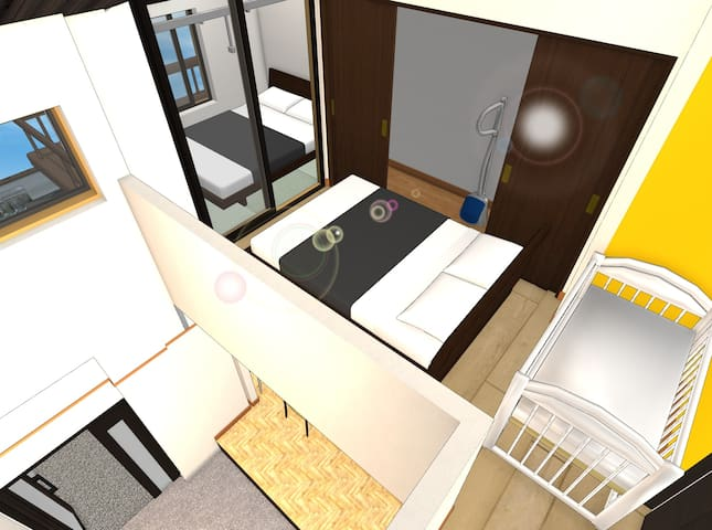 A view of the center room (hallway) and tatami room - double size mattress will be directly on the floor (without bed frame).  A baby cot (Pack'n Play) can be placed as requested.