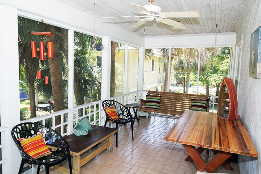 Upstairs screened porch is the perfect place to visit with friends and family