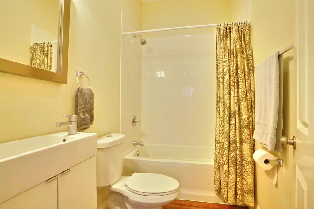 Shower, toilet, sink.