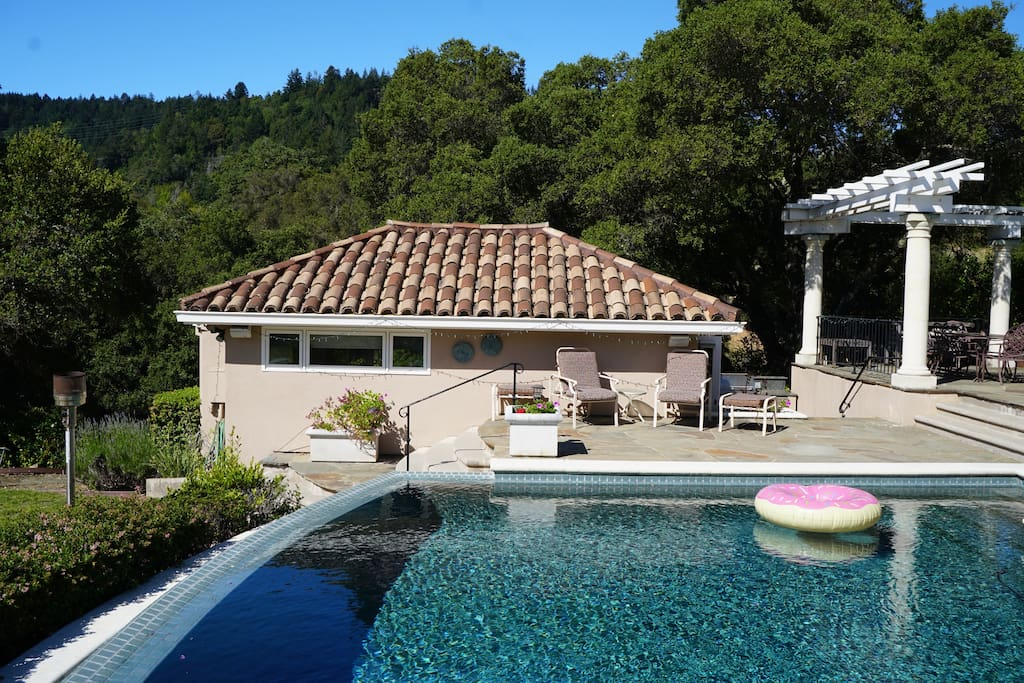 The private Studio Guest House during the day overlooking the pool.