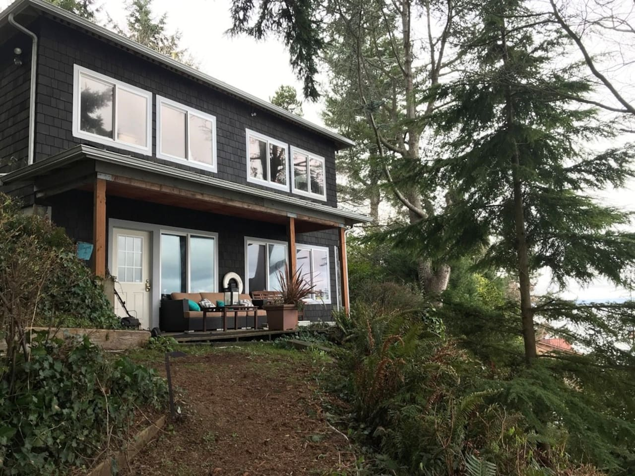 Studio perched just up the hill from the beach.  Lower level is the spacious studio with full views
