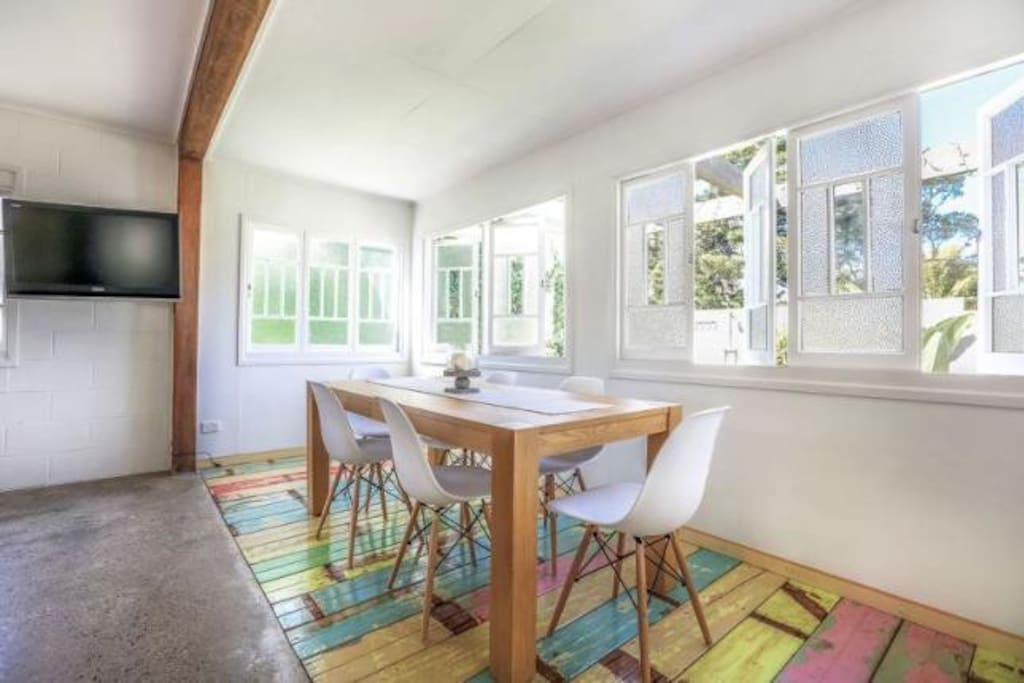 8 seat dining table with Eames chairs