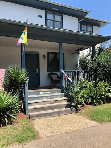 Beach House on 11th St.  Family Friendly apt. entrance is in the back.