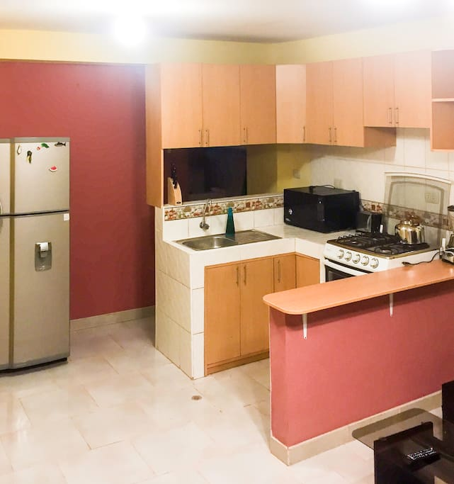 The kitchen is fully equipped with the freezer, microwave oven, toaster , four burner stove. We also have a full kitchen utensils.