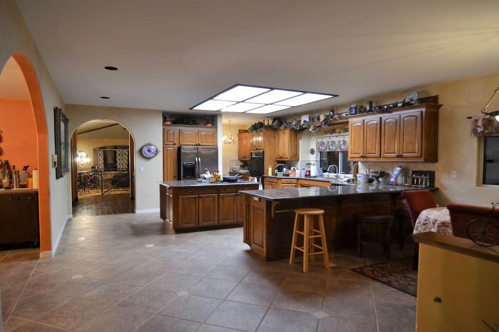 Giant open kitchen with new appliances. Separate pantry and breakfast table