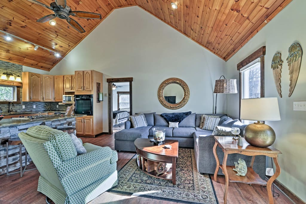 The spacious living area boasts an open floor plan and vaulted ceilings.
