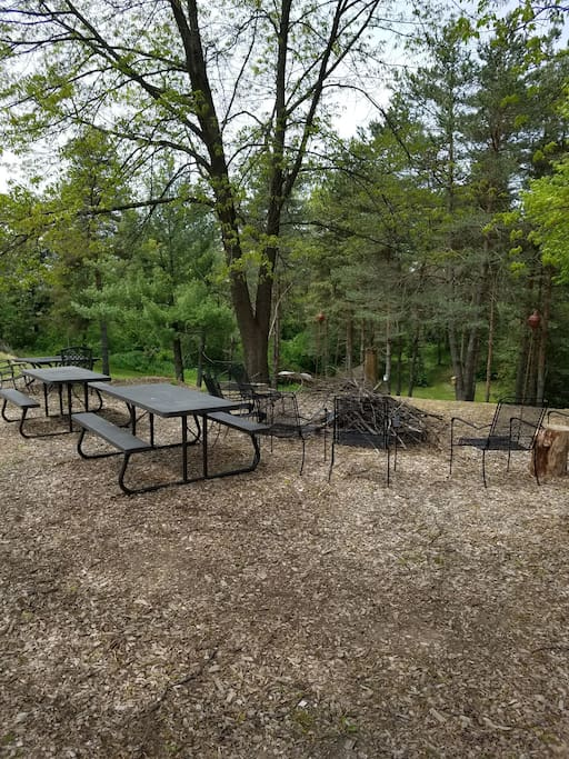 Firepit area complete with chairs, picnic tables and free firewood.