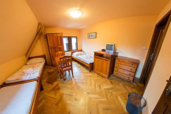 Třílůžkový pokoj s oddělenými postelemi