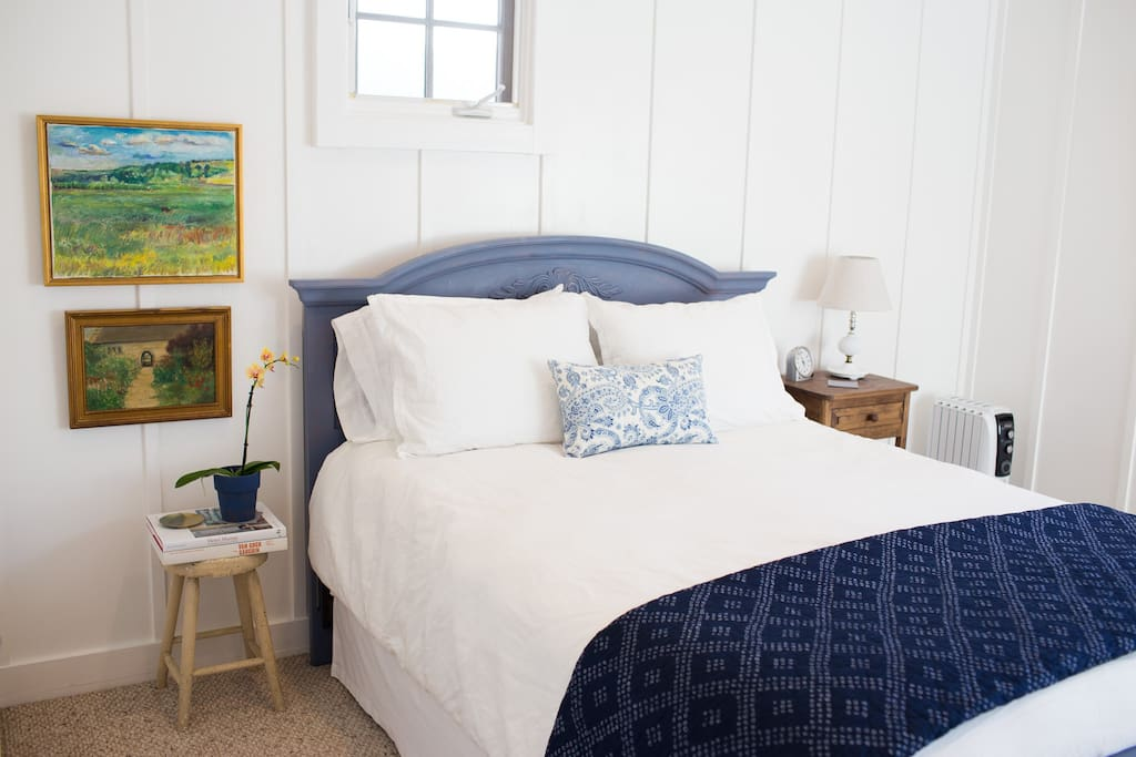 Farmhouse-style bedroom #1. There are two queen bedrooms in the apartment, both light and bright.
