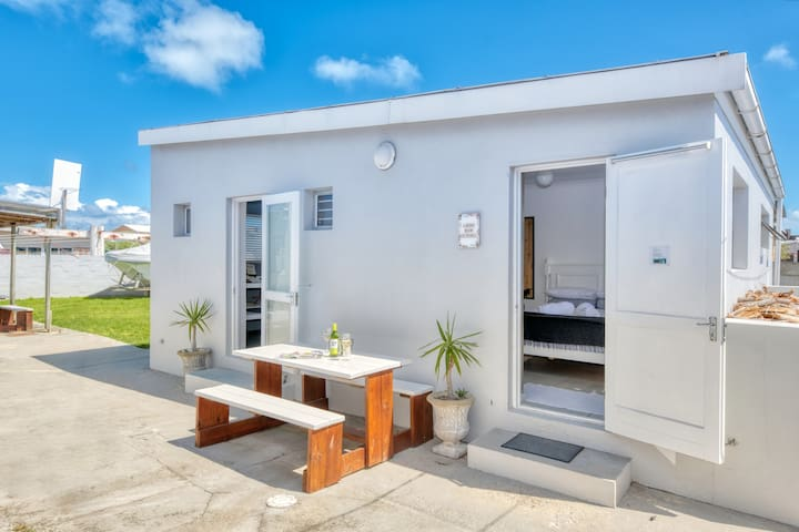 Left is the entrance to your kitchen. Have a glass of wine seated outside and on the right is the entrance to your room