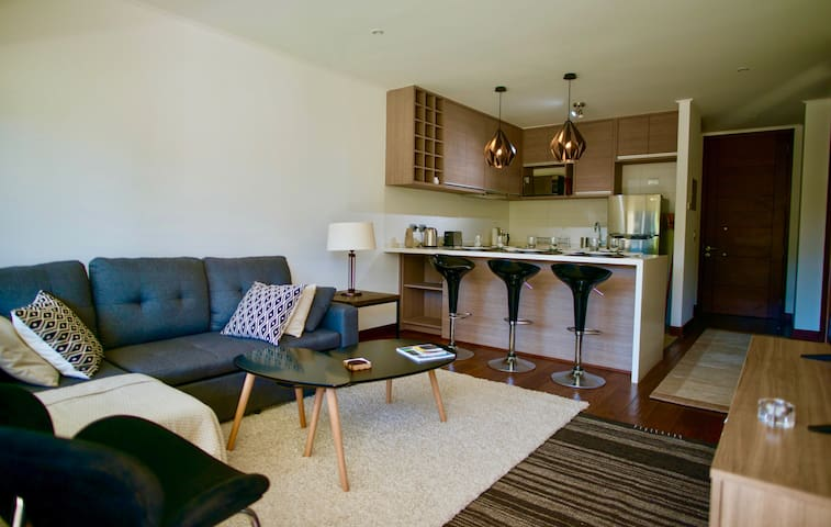 Open living room with cable television.