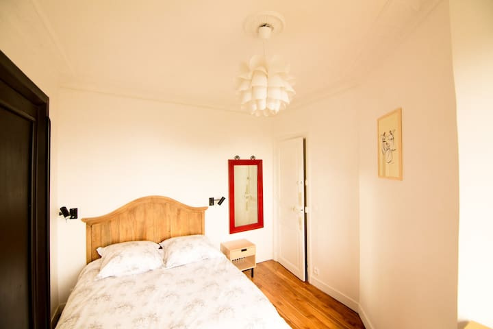 The main bedroom with a large bed for two