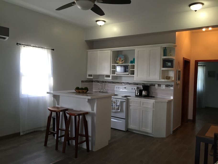 Large fully equipped kitchen with custom build cabinents