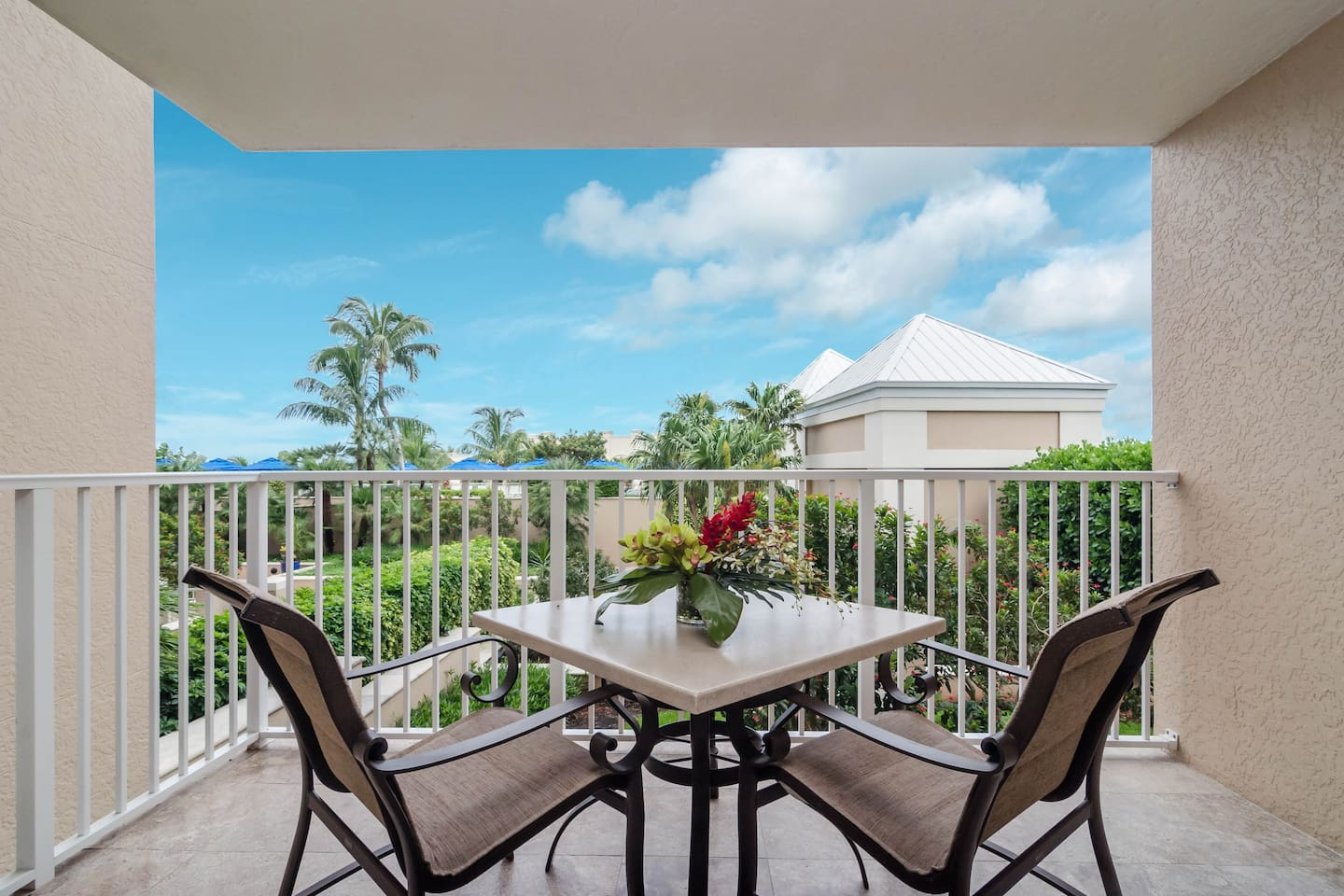 Private balcony overlooking pool and garden terrace