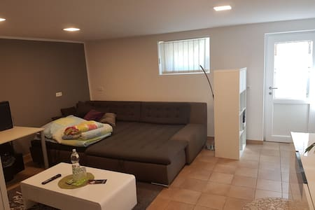 Wohnzimmer mit eigenem Zugang