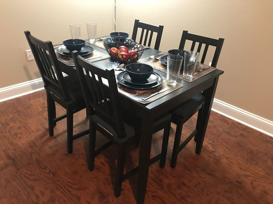 From the front door, you are greeted by your dining area to the right