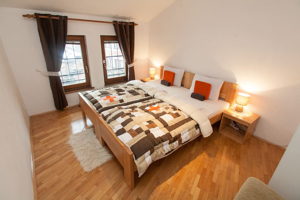 Our cozy double room is perfect for a couple on a few day get-away to Sarajevo. And you see those windows? You can see all of old town Sarajevo through those windows.