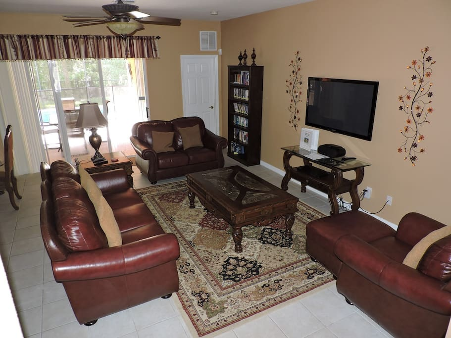 Sitting room with leather sofas and large screen TV