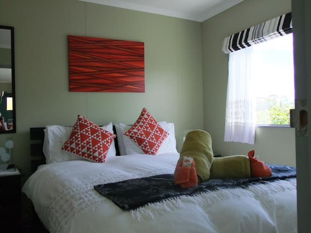 Really comfy bed, great views out onto Kepler Mountains, Fiordland National Park over the gardens