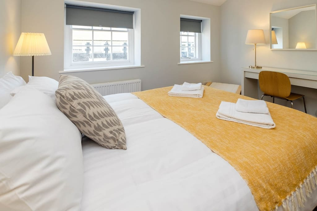Master bedroom with fresh line and  towels for your stay
