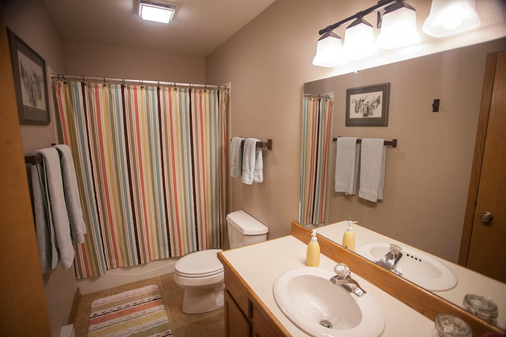 Clean bathroom with soft, luxury towels.